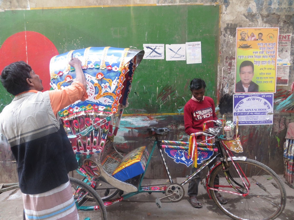 Rickshaw_artists_dhaka_flag_on_wall