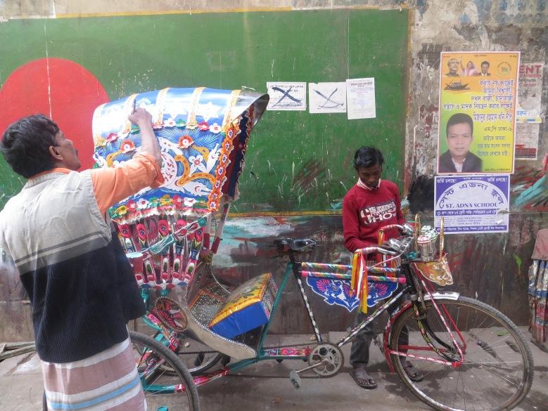 Rickshaw_artists_dhaka_flag_on_wall