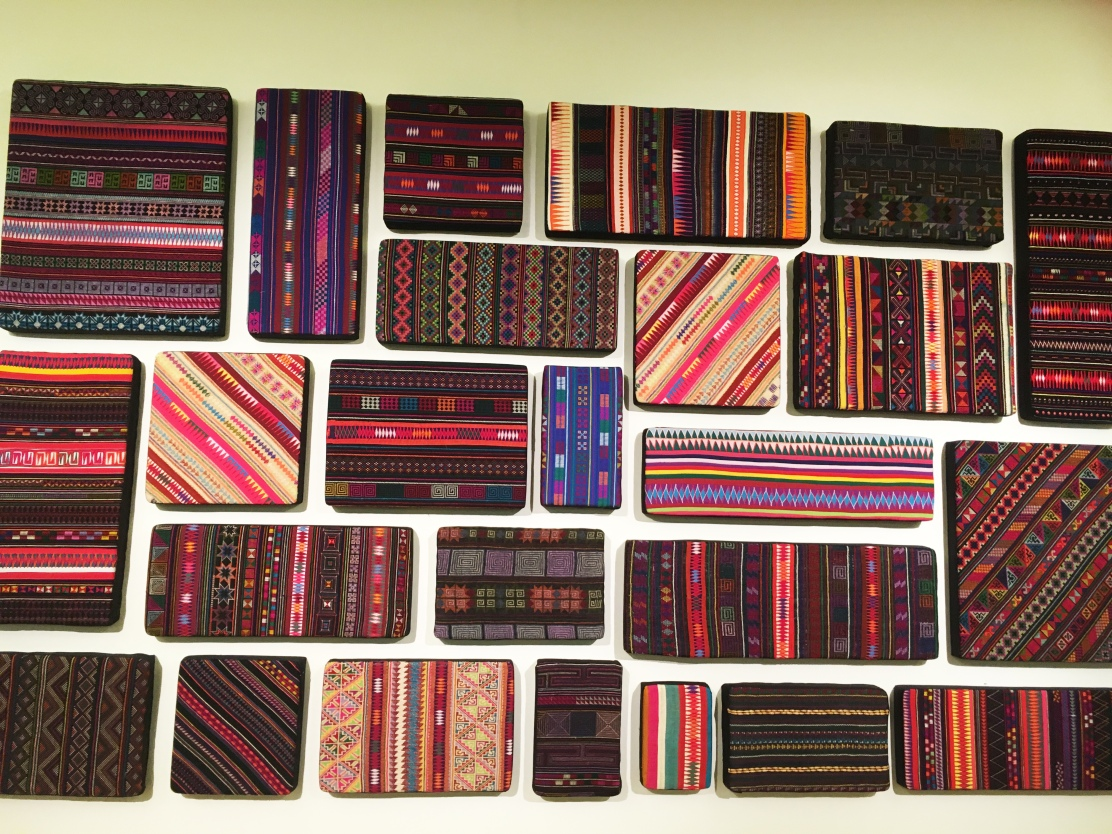 wall of textile techniques at queens gallery bangkok.jpg