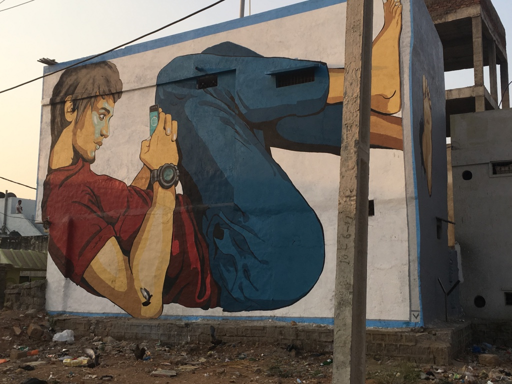 hyderabad_boy on phone_street art